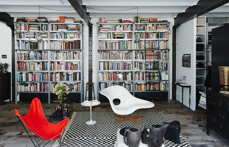 french-evolution-paris-daniel-rozensztroch-living-area-eames-la-chaise-butterfly-chair-moroccan-berber-rug